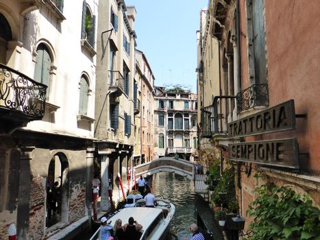 Venice, Italy ��� July 21, 2013:  the Festival of the Redeemer in Venice on July 21, 2013. The Venetians��� favourite event is a thanksgiving to Jesus Christ for the end of the Plague. In three years 1575-1577 the Black Death killed more than half of the inhabitants of Venice in spite of the efforts of the best doctors and the Venetian Senate approved the proposal of the Doge to make a solemn vow to invoke the salvation of the city. The fireworks show is considered the best in Europe and people can watch having dinner on boats or gondole.