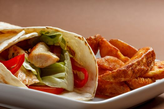 Wraps filled with chicken meat