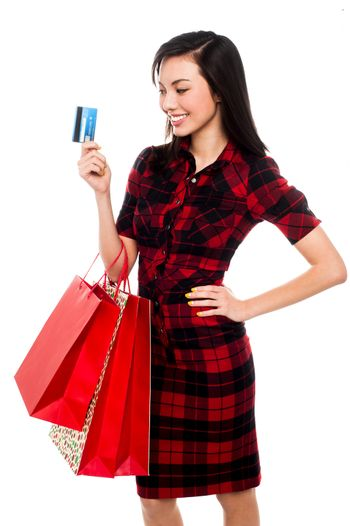 Woman posing with shopping bags and debit card