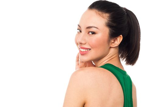 Happy woman looking over her shoulder
