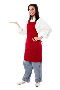 Female chef presenting something