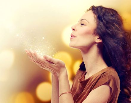 Young Woman Blowing Magic Dust with Stars from her Hands