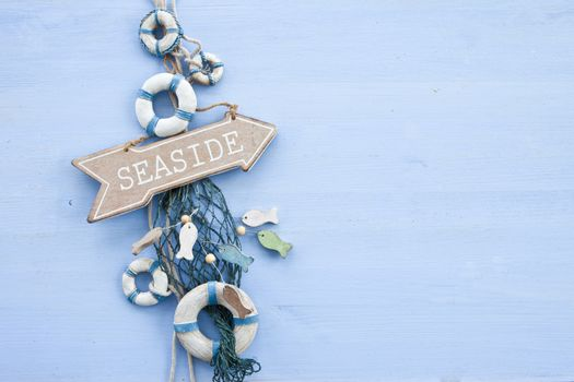 Blue background with a signpost to the seaside