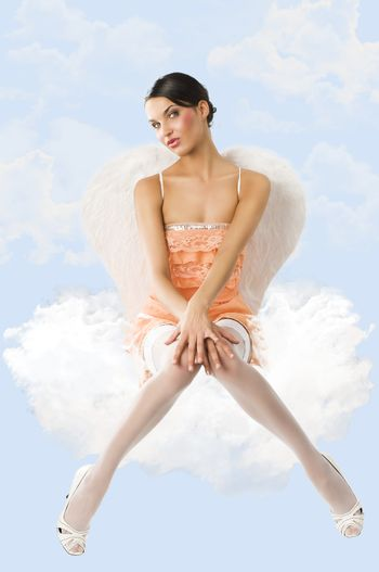 the pinup angel looks in to the lens