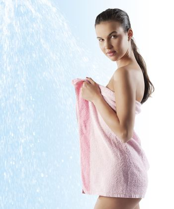 pretty young model with pink towel