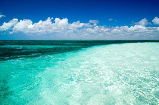 Blue sea under clouds sky