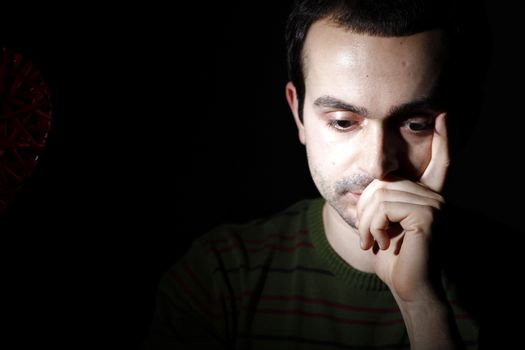 Portrait of a young man, isolated on black background