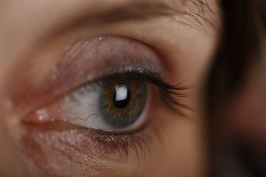 Close up photo of an green woman's eye