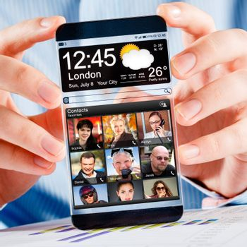 Futuristic Smart phone (phablet) with a transparent display in human hands. Concept actual future innovative ideas and