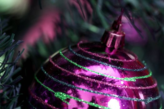 Close up of Christmas ornaments on tree.
