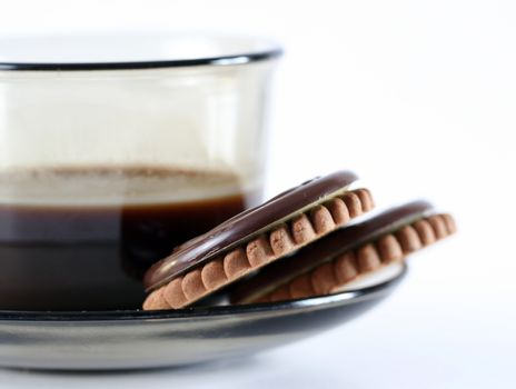 Cup with coffee and cookies.