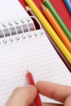 Close-up of pencil and agenda