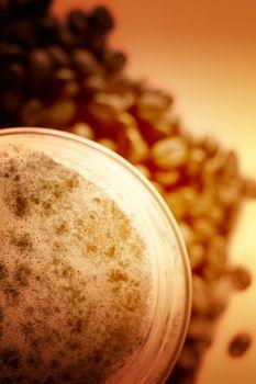 Latte Macchiato in glass costing on coffee grain