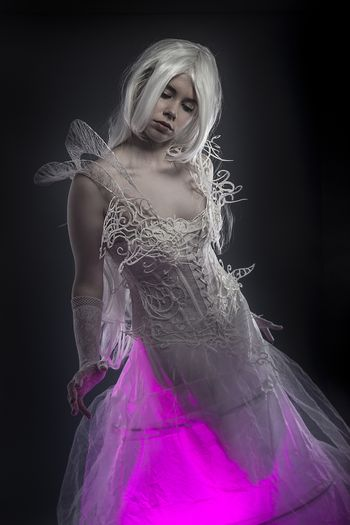 Sexy. Beautiful model with long white hair and vintage corset