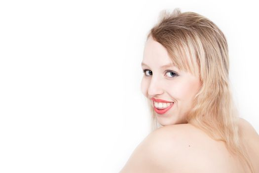 Portrait from young blond woman on a white background with much skin visible