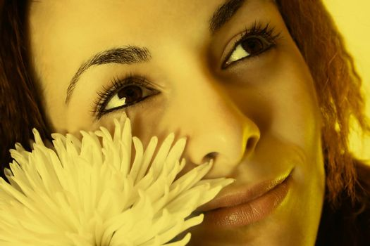 Macro image of a girl face with a white flower