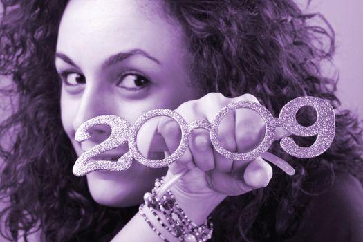 Beautiful woman celebrating the new year.