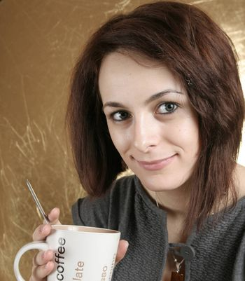 Beautiful woman drinking a cup of coffee