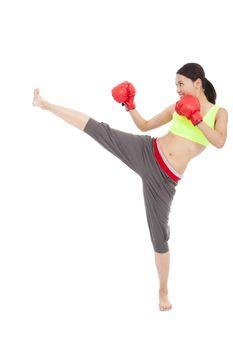 pretty sporty woman is kicking