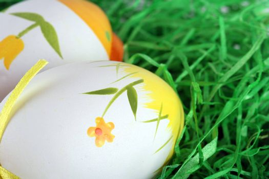 Painted easter eggs in grass.