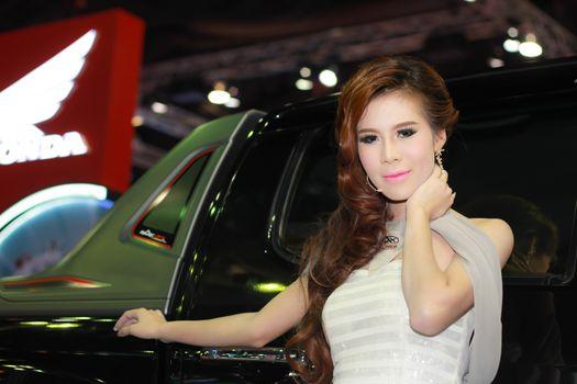 BANGKOK, THAILAND - MARCH 30, 2014: Unidentified female presenter pose in the 35th Bangkok International Motor Show on March 30, 2014 in Bangkok, Thailand.