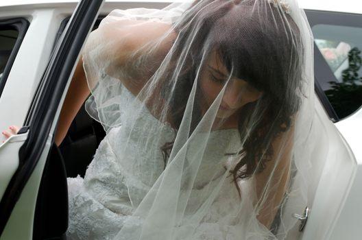 Bride leaving car