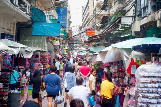 BANGKOK, THAILAND - MARCH 03, 2013: People at a street flee market in Chinatown district in Bangkok. Bangkok Chinatown is popular tourist attraction