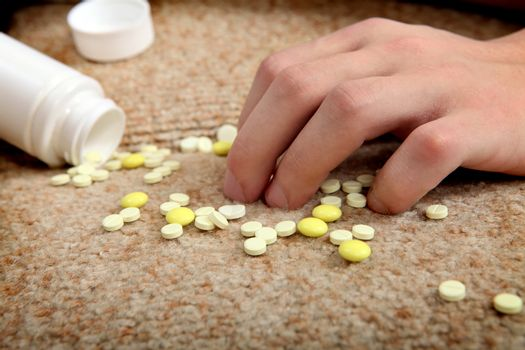 Hand near the scattering Pills