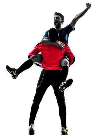 two  soccer player goalkeeper men celebration in silhouette isolated white background