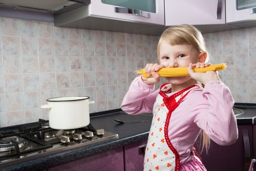 girl with macaroni in the kitchen
