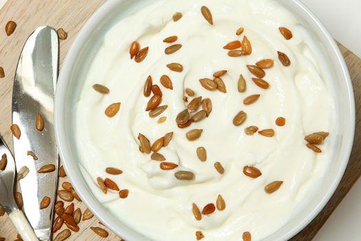 Yogurt with Sunflower Seeds on Table High Angle View