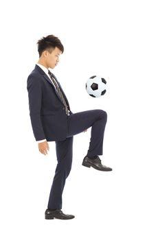 businessman is kicking a soccer