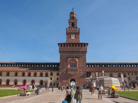 MILAN, ITALY - APRIL 10, 2014: People visiting the Sforza Castle aka Castello Sforzesco which is the oldest castle in town