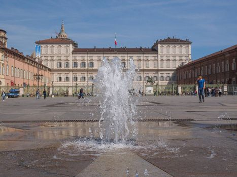 TURIN, ITALY - APRIL 09, 2014: Tourists visiting Piazza Castello, the central baroque square