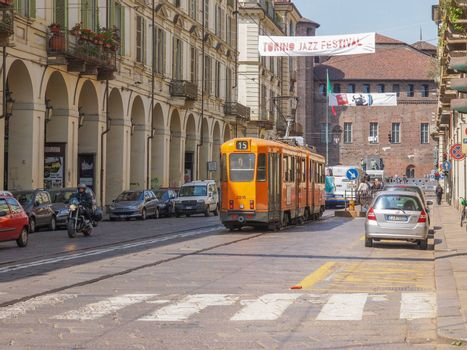 TURIN, ITALY - APRIL 09, 2014: Car traffic in Via Po ancient baroque street