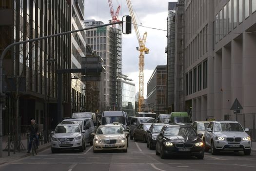 Frankfurt, Germany - February 19, 2014: Standing road due to the traffic lights in the banking district of Frankfurt on February 19, 2014 in Frankfurt.
