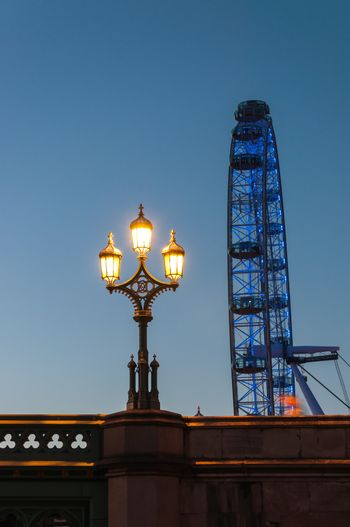 LONDON, UNITED KINGDOM - MAY 10: Lantern and London Eye in the background at dusk on May 10, 2011 in London.