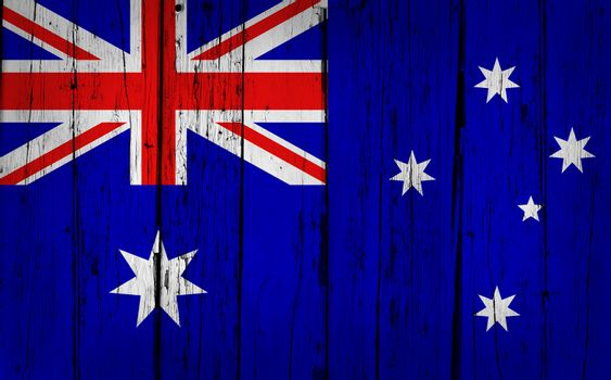 Australia grunge wood background with Australian flag painted on aged wooden wall.