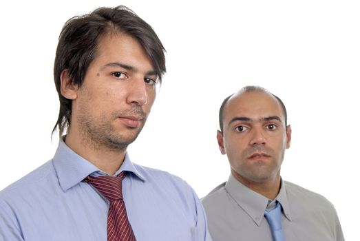 two young business men portrait on white. focus on the right man