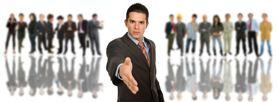 young business man offering his hand in front of a group of people