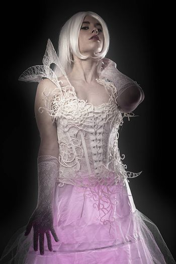 Fantasy concept, sensual young woman with vintage white violin dress