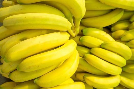 Full frame take of fresh bananas on a market stall