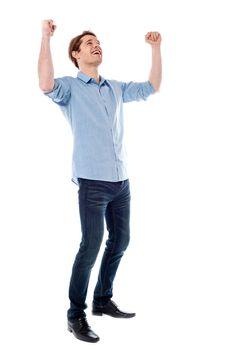 Young man expressing his success