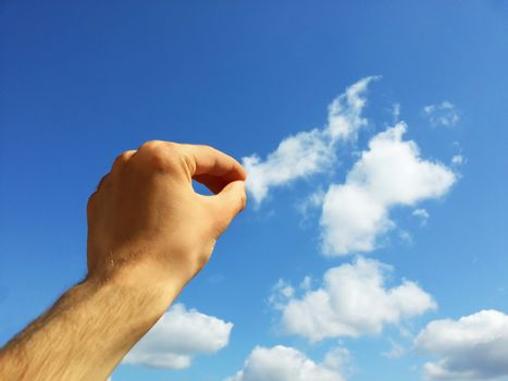Hand pulling cloud with copyspace