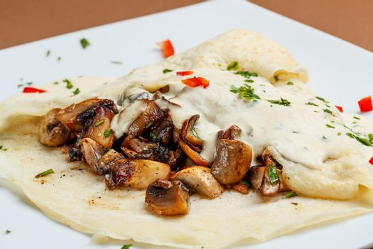 Crepes with mushrooms