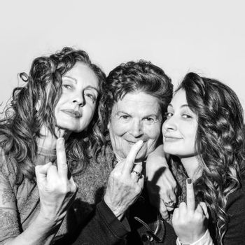 Three women with the middle finger send someone to hell