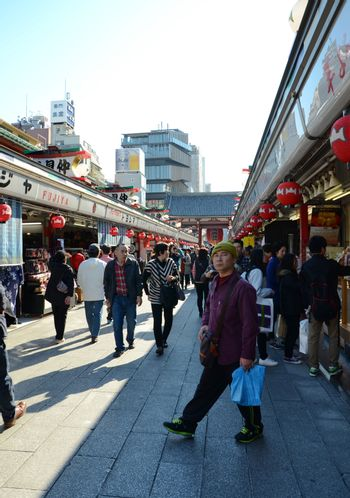TOKYO, JAPAN - NOV 21 : Nakamise shopping street in Asakusa, Tokyo on 21 November 2013. The busy arcade connects Senso-ji Temple to it's outer gate Kaminarimon, which can just be seen in the distance.