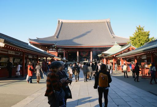 ASAKUSA, JAPAN- NOV 21, 2013: Sensoji temple is very popular temple. The temple is approached via the Nakamise, shopping street, providing tourist souvenirs. Tokyo, Japan. November 21 2013