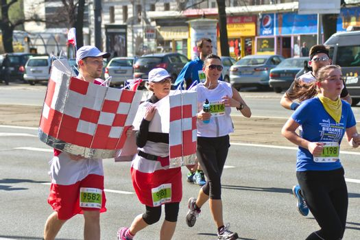 Warsaw, Poland – March  30, 2014: 9th Warsaw Half Marathon. Runners in hilarious and funny costumes