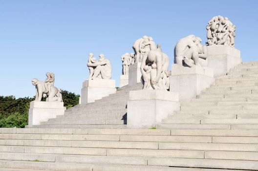 OSLO - JUNE 19: Statues in Vigeland park in Oslo, Norway on June 19, 2012. The park covers 80 acres and features 212 bronze and granite sculptures created by Gustav Vigeland.